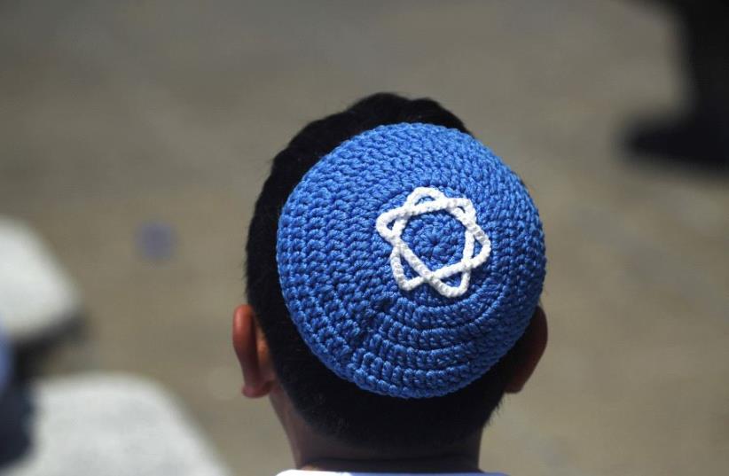 A child wearing a Kippah (photo credit: REUTERS)