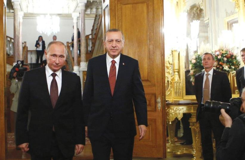 RUSSIAN PRESIDENT Vladimir Putin and his Turkish counterpart Tayyip Erdogan arrive for a joint news conference following their meeting in Istanbul, Turkey, last year. (photo credit: REUTERS)