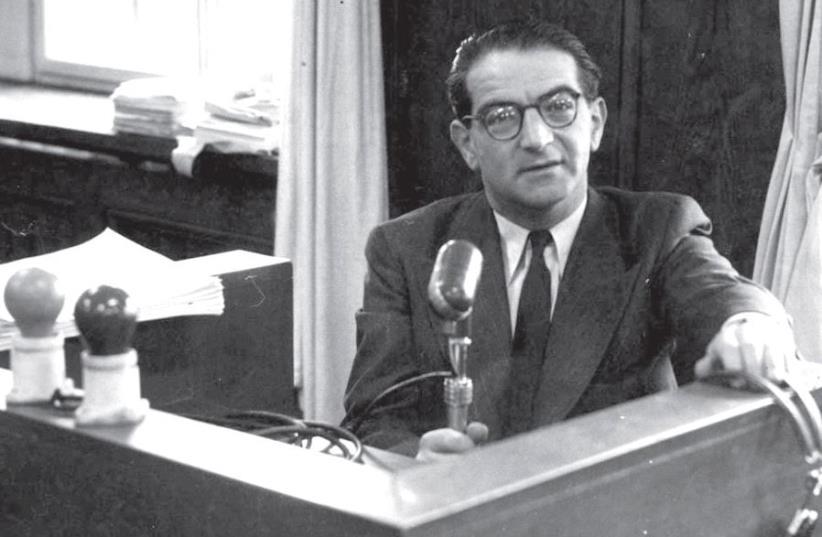 Rudolf Kasztner in a broadcasting booth at Kol Yisrael radio station (photo credit: WIKIPEDIA)