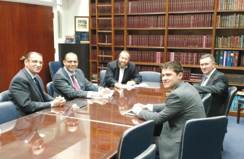 SEATED IN the office of Senator Orrin Hatch (R-UT) in Washington in 2016, from left: Egyptian Embassy officials Khaled El Menshawy and Muhammad Samir, Friedlander Group CEO Ezra Friedlander, and congressional staffers Doug Dynes and JC Cardinale (photo credit: THE FRIEDLANDER GROUP)