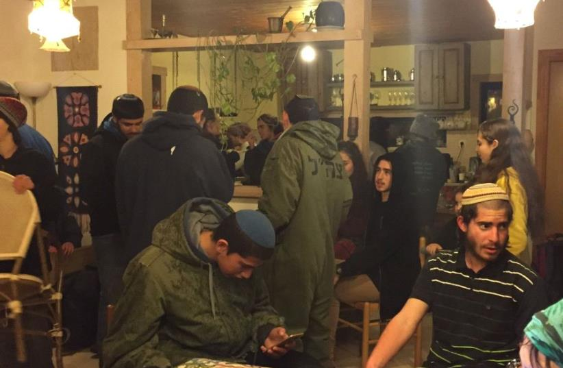 At least 20 teenagers in one Amona home. Playing guitar and just waiting for the evacuation. (photo credit: ANNA AHRONHEIM)