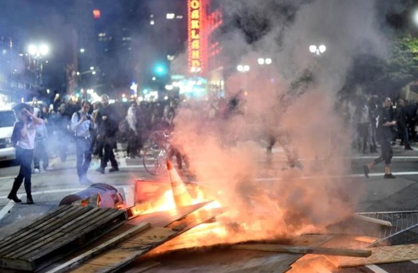Demonstrators riot following the election of Republican Donald Trump as President of the United States, in Oakland, California, U.S., November 9, 2016 (photo credit: REUTERS)