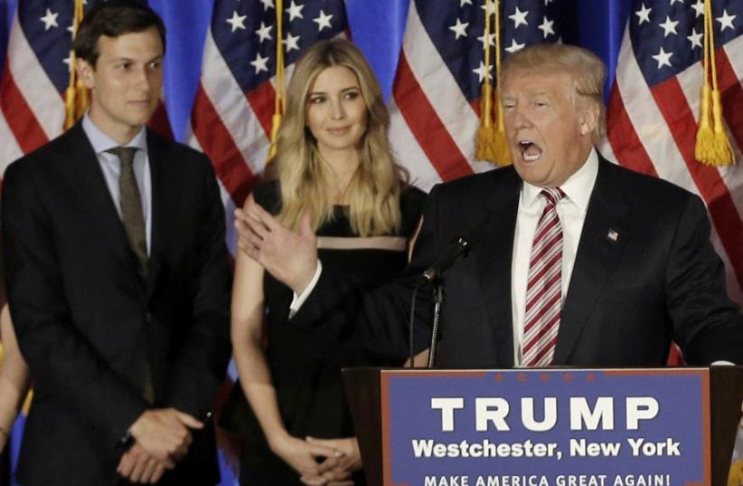 Donald Trump speaks as his son-in-law Jared Kushner and his daughter Ivanka listen. (photo credit: REUTERS)
