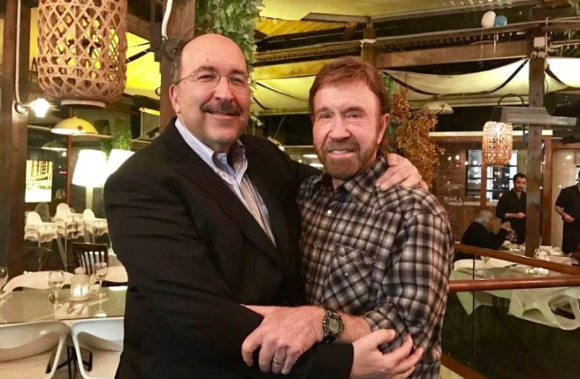 Former Foreign Ministry director-general Dore Gold (L) and actor Chuck Norris in Herzliya, February 4, 2017 (photo credit: TWITTER)