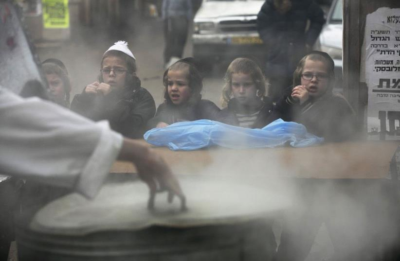 Three out of five children taken to the hospital for burn treatment are hurt by boiling water or other liquids. (photo credit: REUTERS)