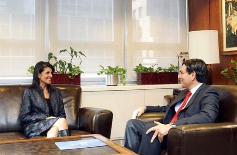Israeli Ambassador to the UN Danny Danon (R) meets with US Ambassador to the UN Nikki Haley in New York (photo credit: TWITTER)