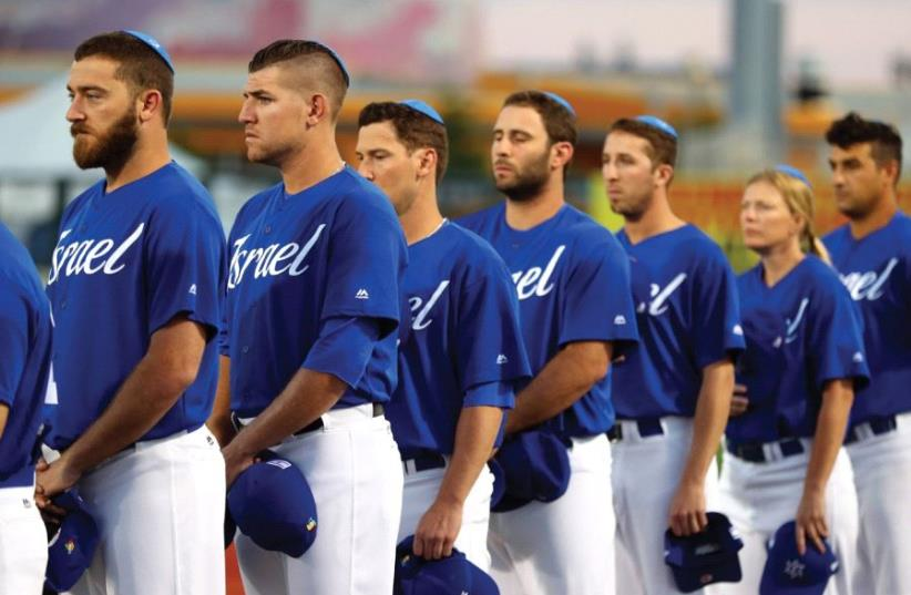Members of Team Israel wearing their kippot during the singing of 'Hatikva' in Brooklyn (photo credit: ALEX TRAUTWIG / MLB PHOTOS VIA GETTY IMAGES)