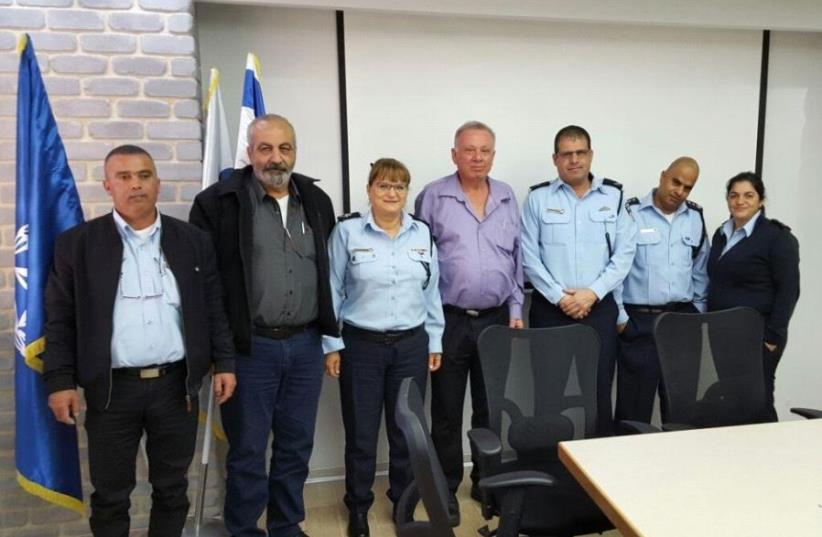 Lawyer Nader Safari (second from right), Assistant Chief Gila Gaziel (third from right), and Zionist Union MK Eitan Broshi (third from right) meet at National Police Headquarters in Jerusalem (photo credit: ISRAEL POLICE)