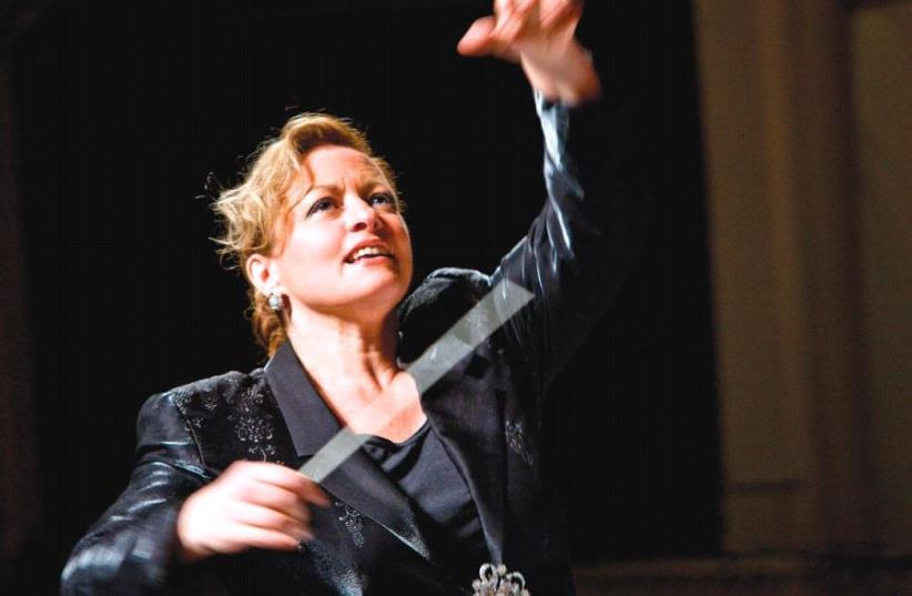 MAESTRO MAGIC: 'You can't see the audience, but you can feel their attention,' says classical conductor Gisele Ben-Dor. (photo credit: HENRY FAIR)