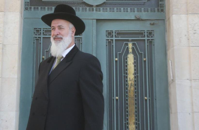 Former chief rabbi Yona Metzger leaves a Jerusalem court last March (photo credit: MARC ISRAEL SELLEM)
