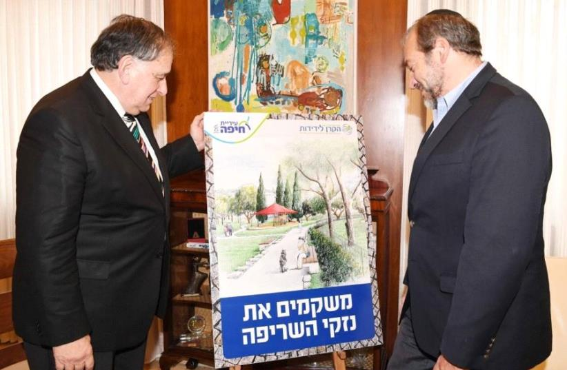 The Fellowship's Rabbi Yechiel Eckstein and Haifa Mayor Yona Yahav look at an artist's rendition of the new playground, in January. (photo credit: FACEBOOK)