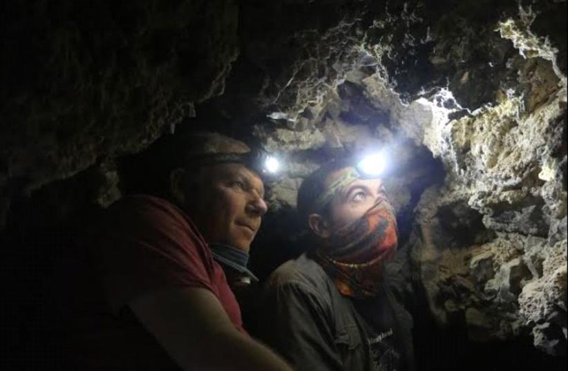 Archaeologists Oren Gutfeld and Ahiad Ovadia survey the cave (photo credit: COURTESY OF CASEY L. OLSON AND OREN GUTFELD)