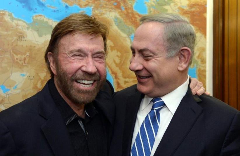 Benjamin Netanyahu and Chuck Norris  (photo credit: CHAIM TZACH/GPO)
