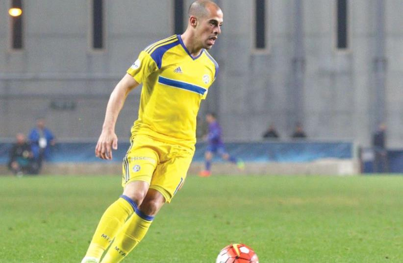 Maccabi Tel Aviv winger Tal Ben-Haim scored the only goal of last night's 1-0 win over Maccabi Petah Tikva in the first leg of the State Cup quarterfinals (photo credit: ADI AVISHAI)