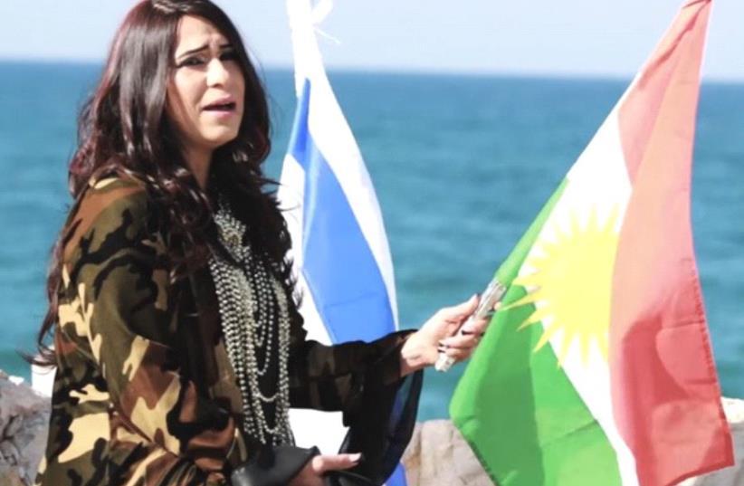 Hadassa Yeshurun holds Kurdish and Israeli flags in her music video (photo credit: YOUTUBE SCREENSHOT)