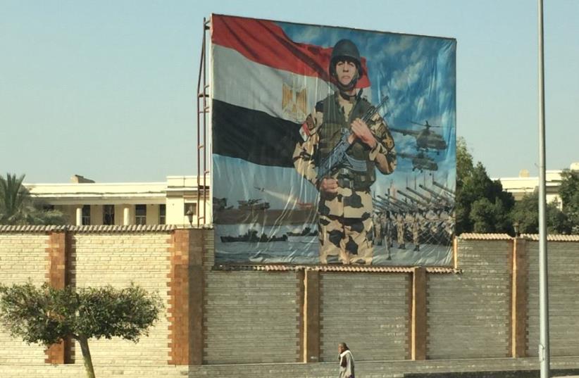 A poster celebrates the Egyptian army in Cairo. (photo credit: SETH J. FRANTZMAN)