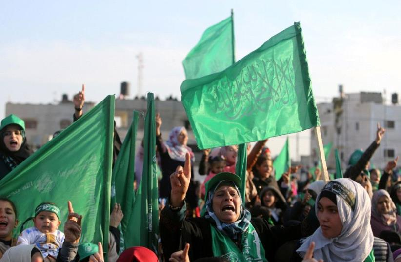 Palestinians take part in a rally marking the 29th anniversary of the founding of the Hamas movement, in Rafah in the southern Gaza Strip December 16, 2016 (photo credit: REUTERS)