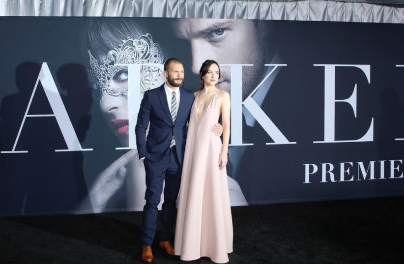 Cast members Jamie Dornan and Dakota Johnson pose at the premiere of the film 'Fifty Shades Darker' in Los Angeles last week (photo credit: REUTERS)