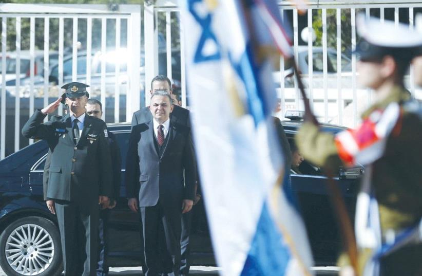 TURKISH AMBASSADOR Kemal Okem stands at attention for the Turkish national anthem before presenting his credentials to President Reuven Rivlin on December 12, 2016. (photo credit: REUTERS)