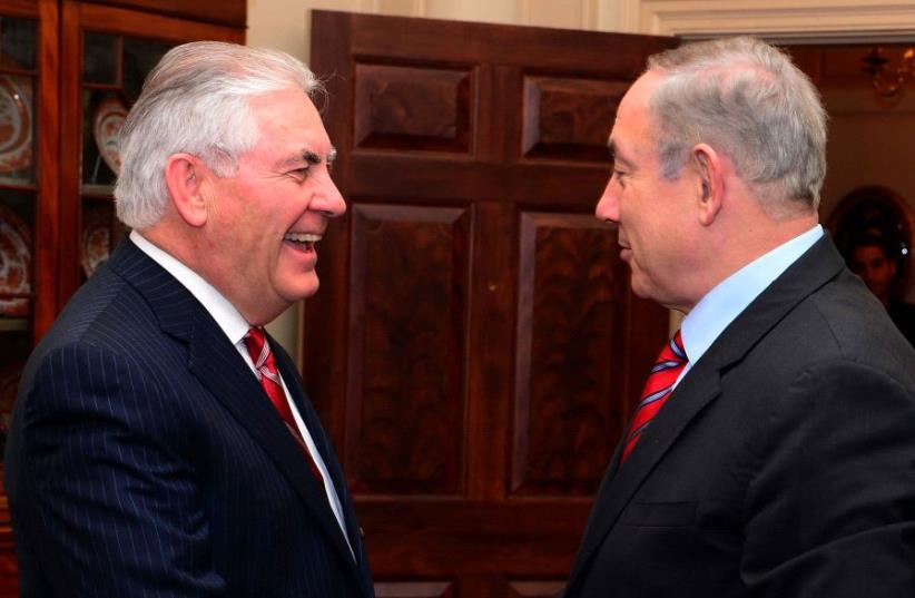 Benjamin Netanyahu and Rex Tillerson  (photo credit: AVI OHAYON - GPO)