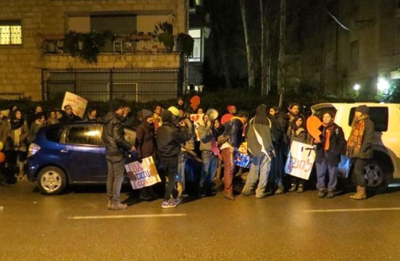 Demonstrators protest in front of Barkat's Jerusalem home on Tuesday night. (photo credit: AMIR PAVILION)