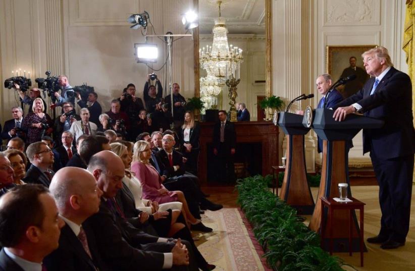 Benjamin Netanyahu and Donald Trump give press conference at the White House in Washington on Feb. 15, 2017 (photo credit: AVI OHAYON - GPO)