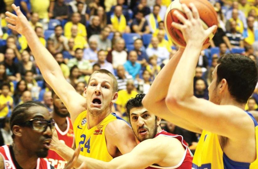 Hapoel Jerusalem and Maccabi Tel Aviv register another chapter in their bitter rivalry tonight when they meet in the State Cup final, with Maccabi captain Guy Pnini (right), Jerusalem center Amar'e Stoudemire (left), Tel Aviv center Colton Iverson (second left) and Jerusalem's veteran forward Lior E (photo credit: ADI AVISHAI)