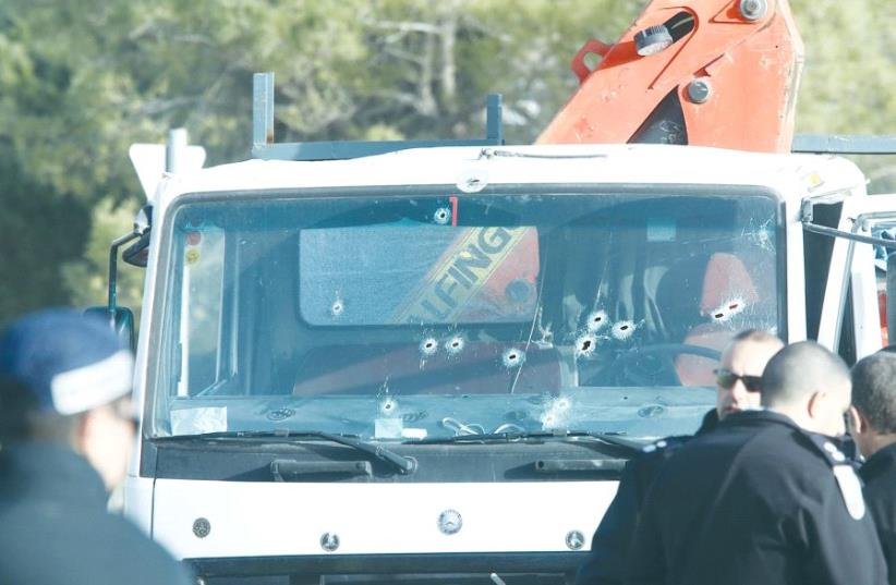 The truck that hit the soldiers, seen with some of the holes of the bullets that eventually stopped the attacker (photo credit: MARC ISRAEL SELLEM)