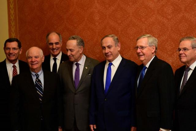 Netanyahu and US Congress members, including Senator Chuck Schumer next to the prime minister on the left (photo credit: AVI OHAYON - GPO)