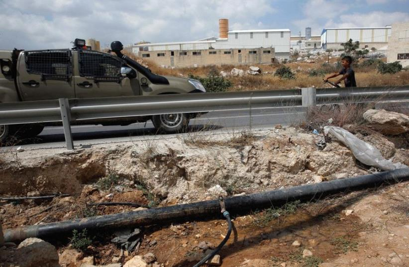 Where is this pipe leading? A water pipe near Hebron last year (photo credit: REUTERS)
