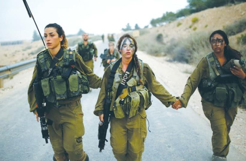 CARACAL BATTALION soldiers march in the Negev in 2014. (photo credit: REUTERS)