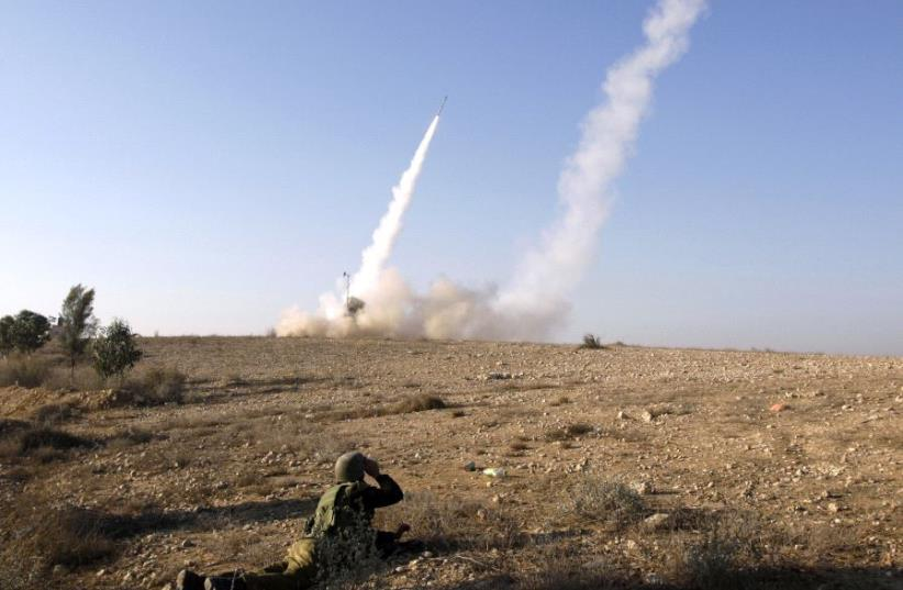Iron Dome launcher fires an interceptor rocket  (photo credit: REUTERS)