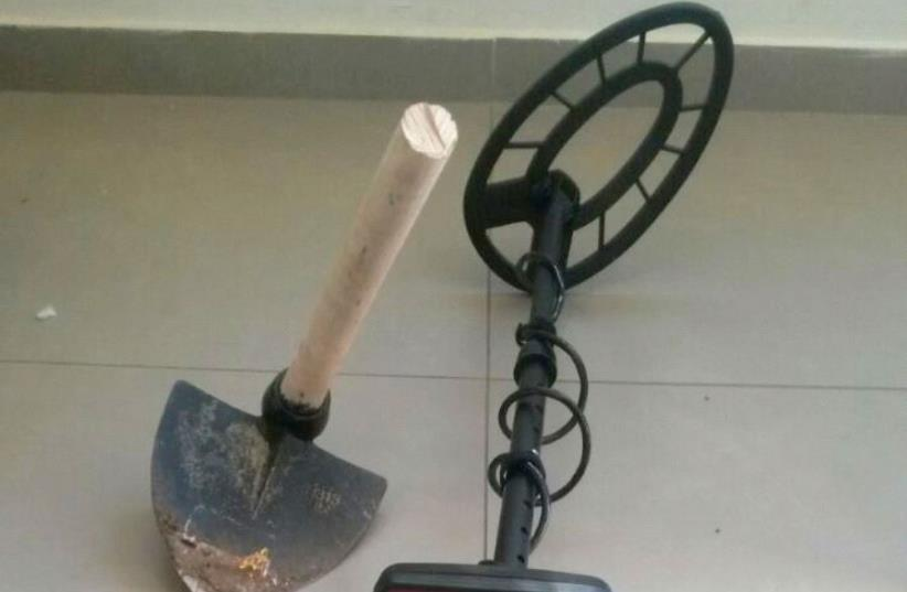 Seized metal detector and pickax used in suspected antiquities theft (photo credit: COURTESY OF IAA ROBBERY PREVENTION UNIT)