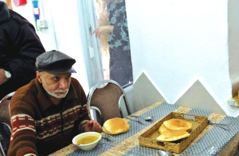 Bread is served at a soup kitchen in central Israel (photo credit: REUTERS)
