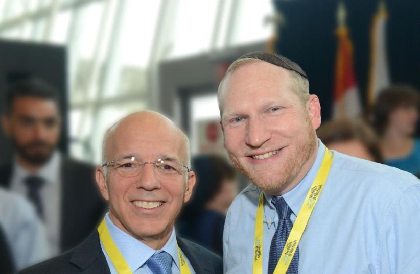 NEFESH B'NEFESH co-founders Rabbi Yehoshua Fass and Tony Gelbart.  (photo credit: SHACHAR AZRAN NEFESH B'NEFESH)
