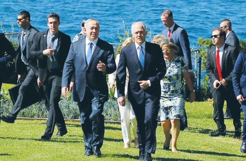 PRIME MINISTER Benjamin Netanyahu walks alongside Australian Prime Minister Malcolm Turnbull upon their arrival at Admiralty House in Sydney. (photo credit: REUTERS)