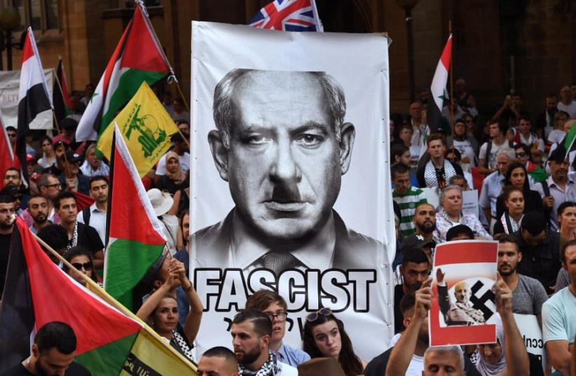 Pro-Palestinian protesters demonstrate against the visit to Australia by Israel's Prime Minister Benjamin Netanyahu, in Sydney on February 23, 2017 (photo credit: WILLIAM WEST/AFP)