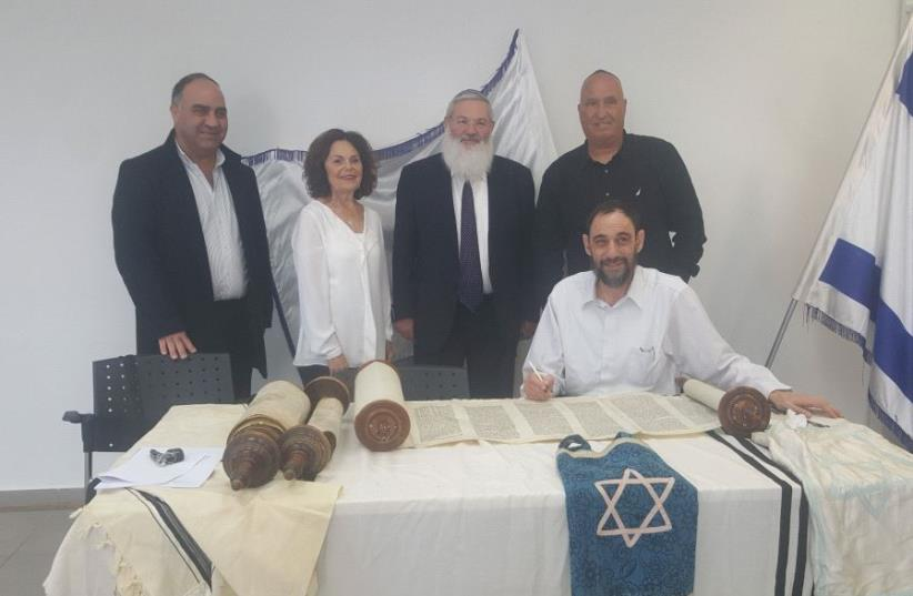 Torah scrolls given to Yad Labanim (photo credit: RACHEL LANIADO)