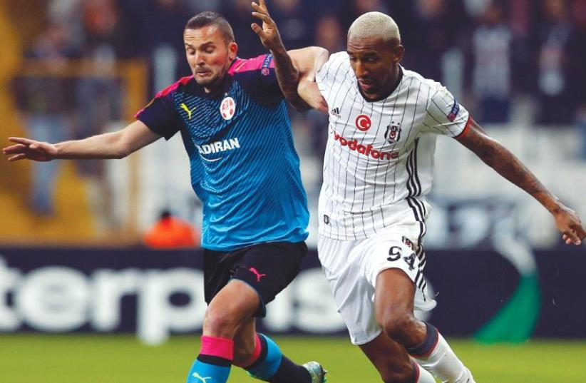 Despite Hapoel Beersheba and Ben Sahar's (left) best efforts, the Israeli champion was knocked out in the Europa League round of 32 last night, losing 2-1 to Besiktas and Talisca (right) in Istanbul for a 5-2 aggregate defeat. (photo credit: REUTERS)