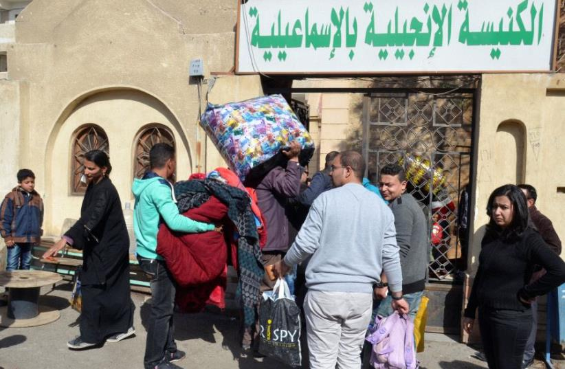Christian families who left from Al-Arish in the North Sinai Governorate after the escalation of a campaign targeting Christians by Islamic State militants  (photo credit: REUTERS)