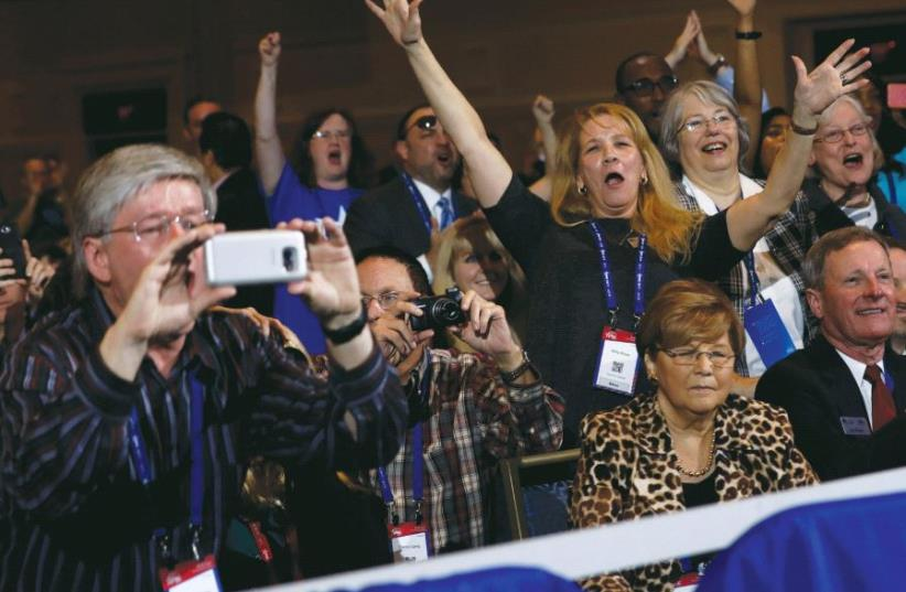 People cheer as US President Donald Trump addresses the Conservative Political Action Conference (CPAC) in Oxon Hill, Maryland (photo credit: REUTERS)