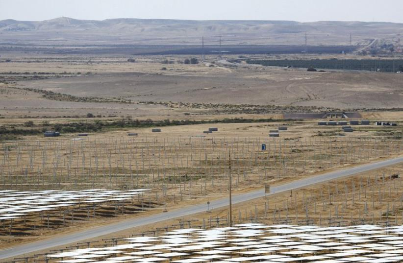 Heliostat mirrors are seen during the construction of a solar-power field in the Negev (photo credit: REUTERS)