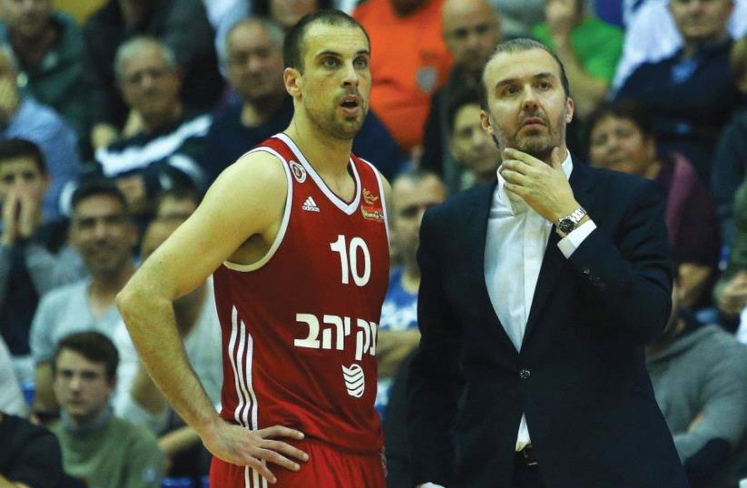 Hapoel Jerusalem coach Simone Pianigiani (right) and captain Yotam Halperin called on the team's fans to pack the Jerusalem Arena tonight in Game 1 of the Eurocup quarterfinal series against Spain's Gran Canaria.  (photo credit: UDI ZITIAT)
