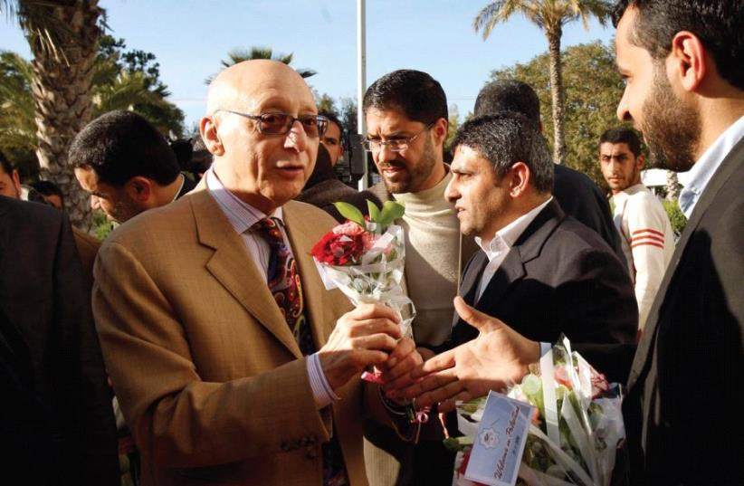HAMAS LAWMAKERS welcome MP Gerald Kaufman upon his arrival at the Rafah border crossing in the southern Gaza Strip in 2010 (photo credit: REUTERS)