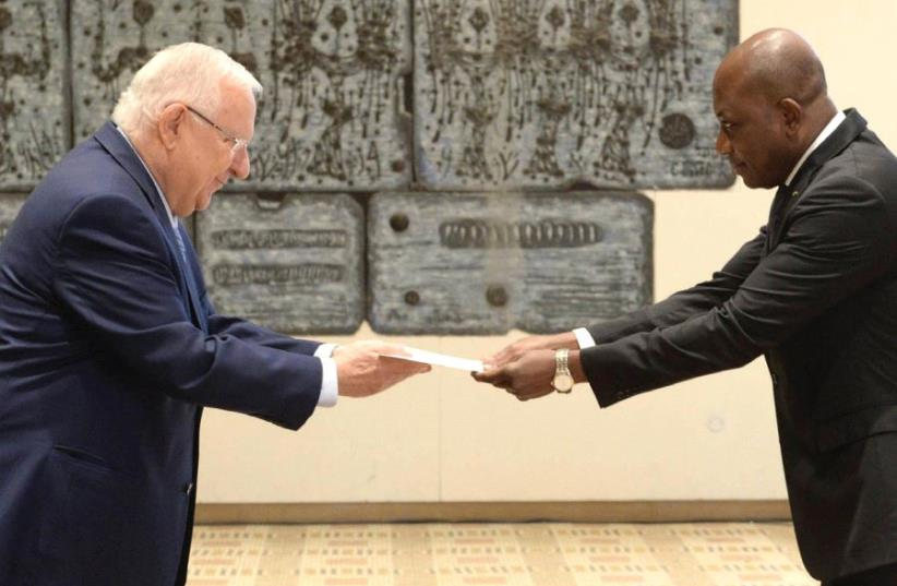CALIXTE BATOSSIE MADJOULBA of Togo presents his credentials to President Reuven Rivlin at the President's Residence in the capital yesterday (photo credit: Mark Neiman/GPO)