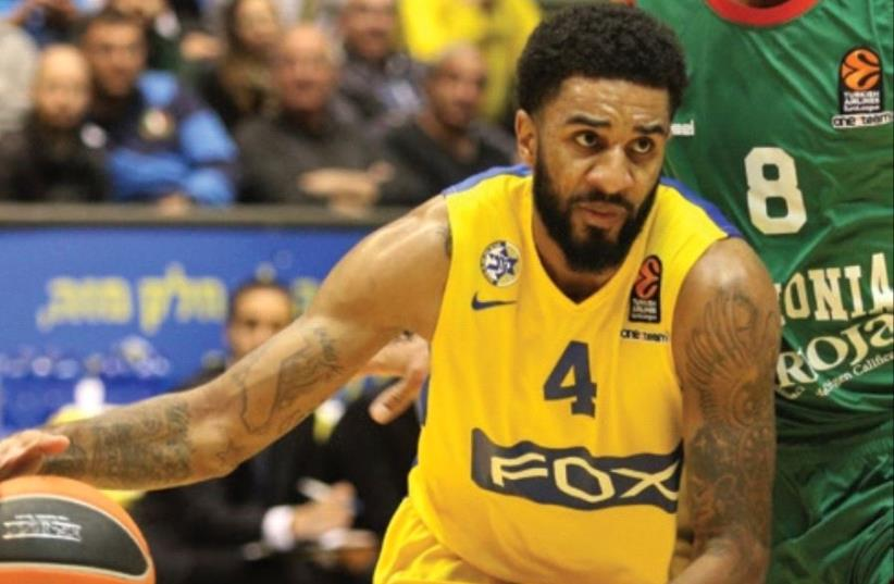 Maccabi Tel Av iv guard D.J. Seeley is set to be handed a bigger role than usual against Olympiacos in Euroleague action tonight, with the yellow-andblue having just eight fit senior players (photo credit: ADI AVISHAI)