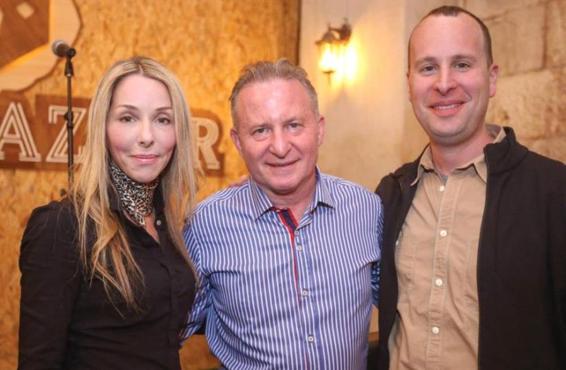 RONIT HASIN-HOCHMAN, CEO Jerusalem Post Group, with Steve Linde (center) and Yaakov Katz at the Beer Bazaar in the capital's Mahaneh Yehuda market. (photo credit: MARC ISRAEL SELLEM/THE JERUSALEM POST)