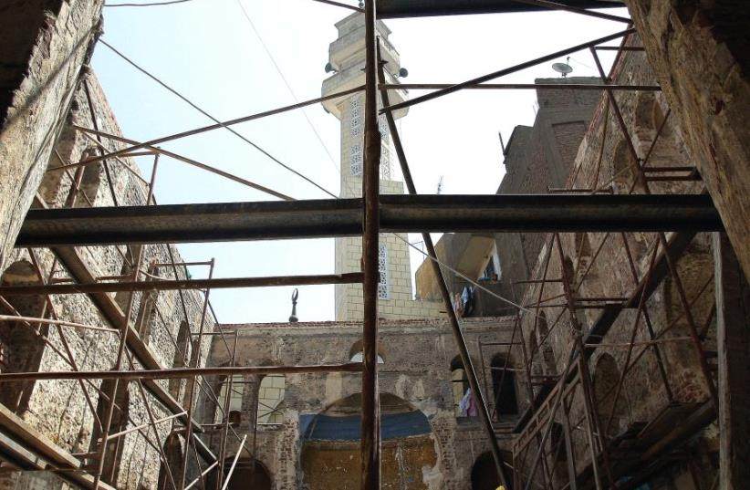 EGYPTIAN WORKERS carry out restoration work at a synagogue in Cairo. (photo credit: REUTERS)