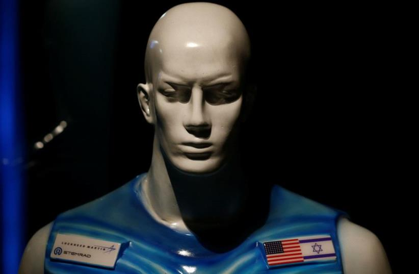 A sculpture of a man wearing Stemrad's new protective vest, Astrorad, is seen at an exhibit at Madatech, National Museum of Science Technology and Space in Haifa, Israel February 23, 2017. Picture taken February 23, 2017 (photo credit: REUTERS)