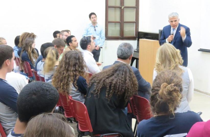 Yesh Atid leader Yair Lapid addressing Nazareth Illit students  about the legacy of former Likud Prime Minister Menachem Begin (photo credit: COURTESY YESH ATID)